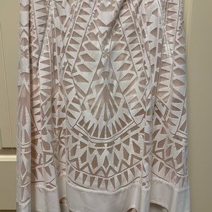 BCBG white skirt with cut outs